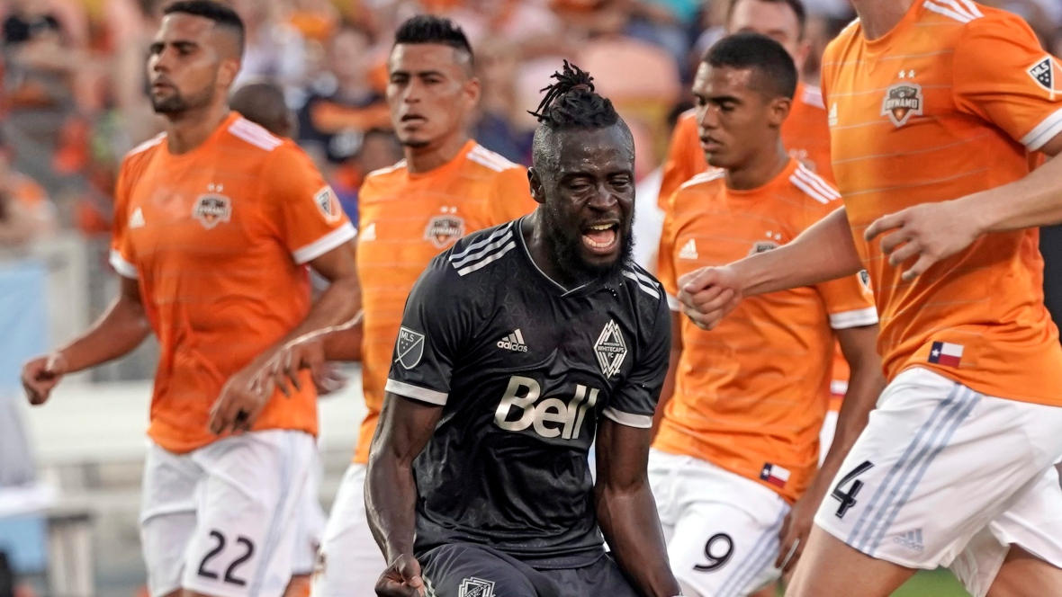 """alt=""""Kei Kamara of the Whitecaps celebrates after scoring a penalty kick during Vancouver's 2-1 win over the Houston Dynamo on Saturday. (David J. Phillip/Associated Press)"""""""