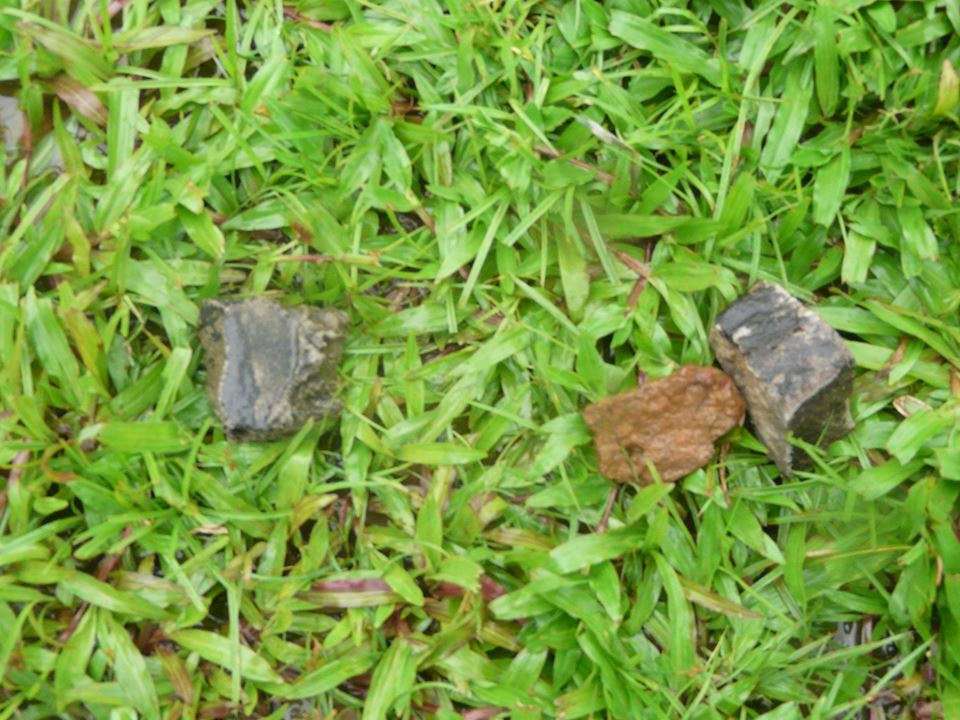 Photos of stones inside the Siaka Steven Stadium pitch